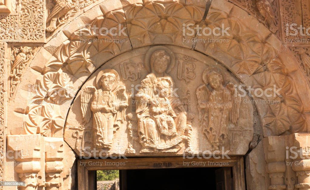 Noravank Monastery in Armenia. Relief over the door of the Virgin Mary with angels stock photo