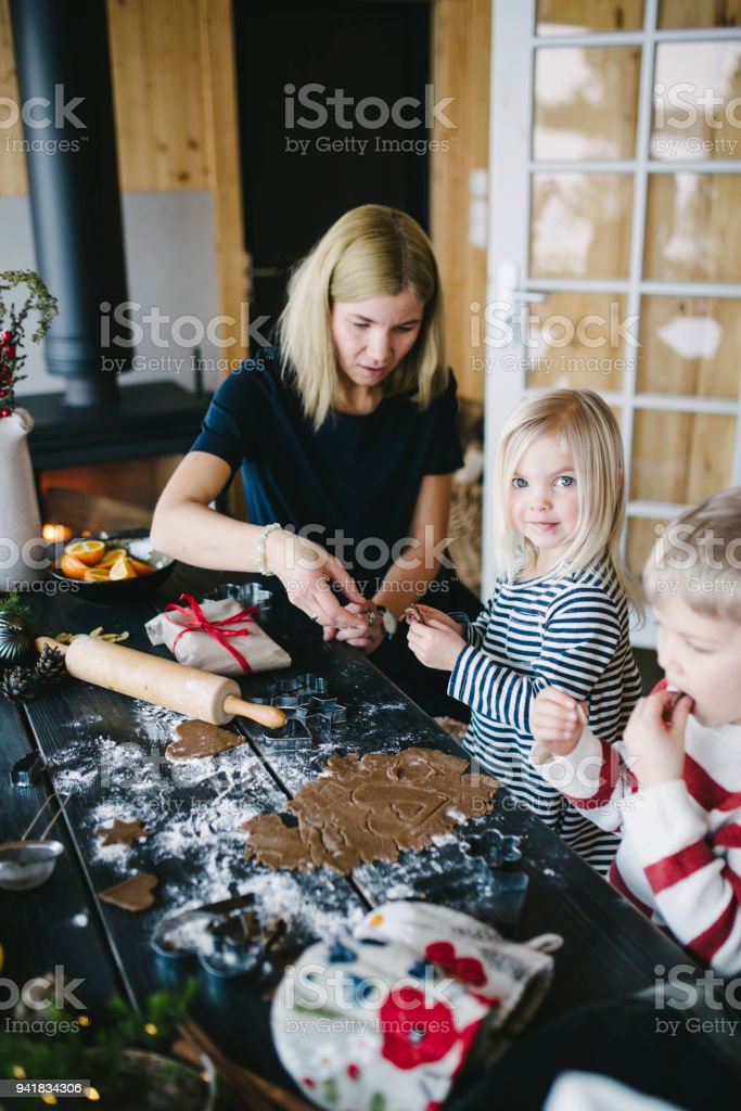 Nordic family at home making cookies for Christmas stock photo