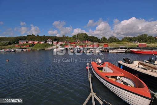 Scandinavian bay with fishing boats and wooden houses. Summer vacation on the island Bornholm