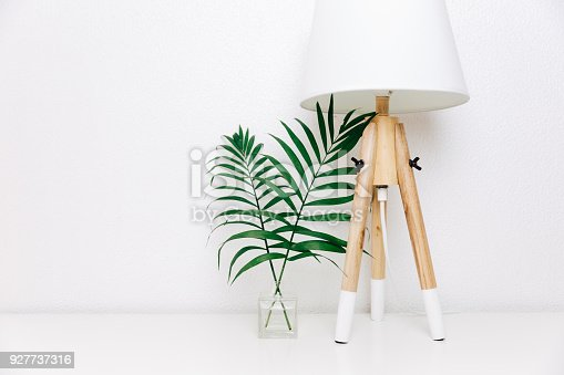 istock Nordic living room. Scandinavian lamp and tropical leaves. Eclectic Minimal home decor 927737316