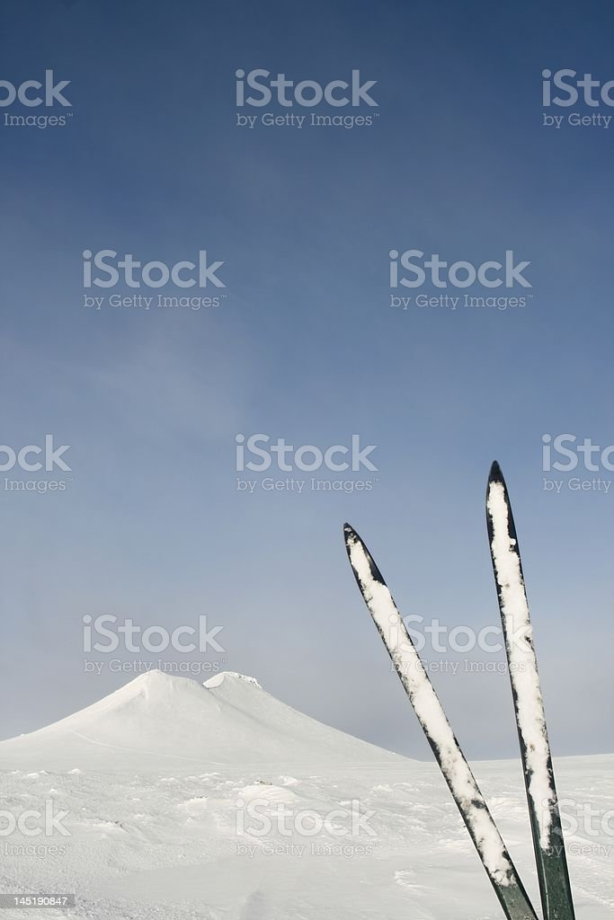 Nordic skis and summit stock photo