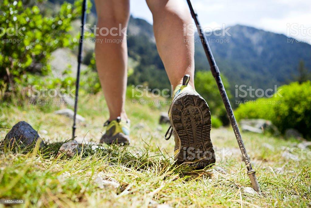 Nordic walking legs in mountains royalty-free stock photo