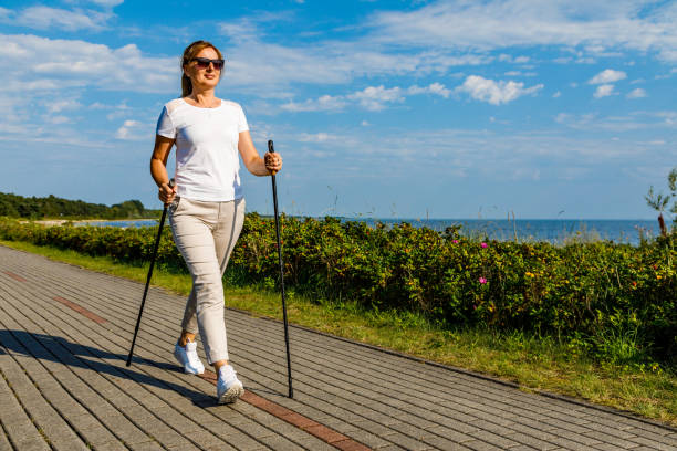 Nordic walking - woman training at seaside Nordic walking - woman training at seaside nordic walking stock pictures, royalty-free photos & images