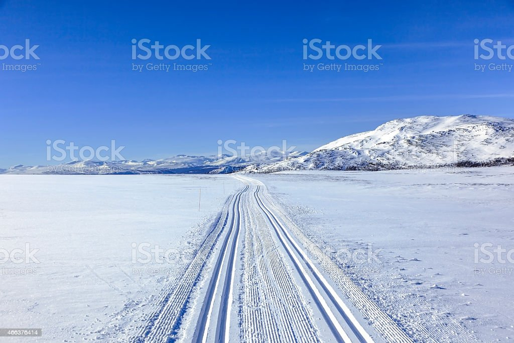 Nordic winter  with blue skies in the mountains. stock photo