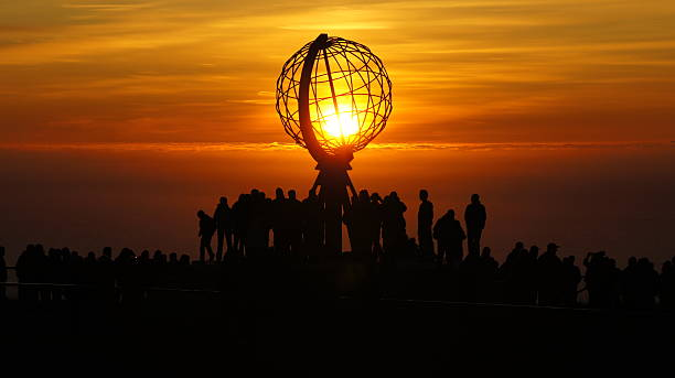 Nordkapp  North Capp Sunset during white night. headland stock pictures, royalty-free photos & images