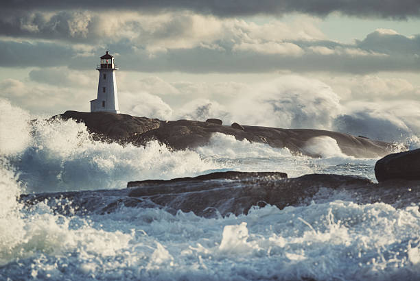 Nor'Easter at Peggy's Peggy's Cove Lighthouse is inundated with surf associated with a violent Nor'Easter. rocky coastline stock pictures, royalty-free photos & images