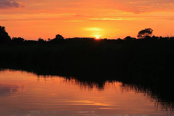Norfolk Broads Setting Sun Reflection stock photo