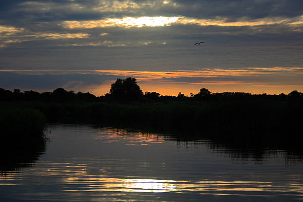 Norfolk Broads Sunset Reflection stock photo