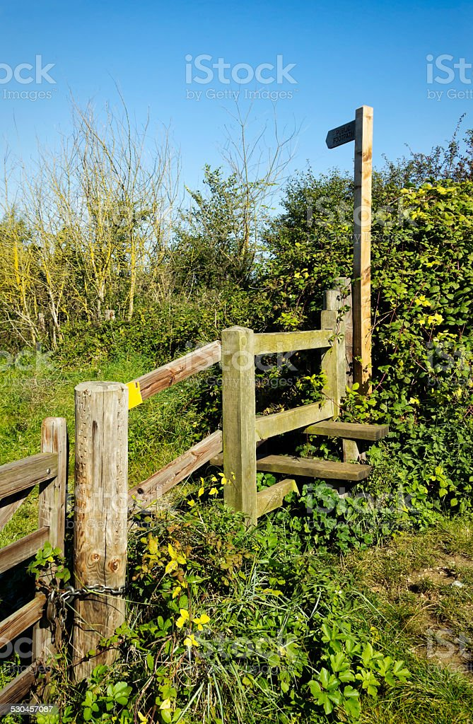 Norfolk footpath sign and stile stock photo