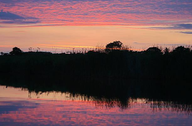 Norfolk Sunset Reflection stock photo