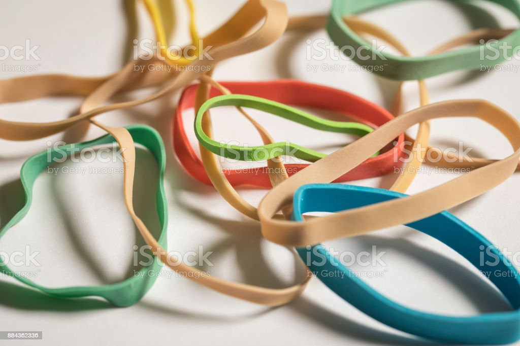 Normal And Colored Rubber Bands stock photo