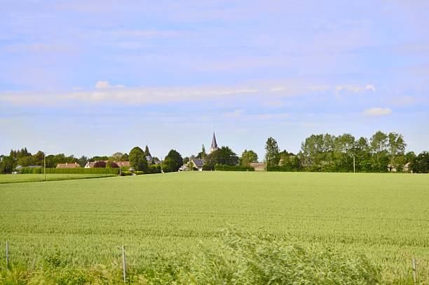 normandie farm village - kirchturmspitze stock-fotos und bilder