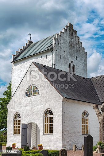 The old white norra vrams church in the swedish village of Billesholm.