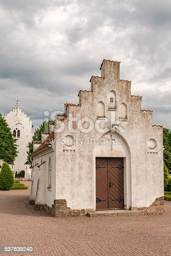 The small white graveyard chapel at norra vrams church in the swedish village of Billesholm.