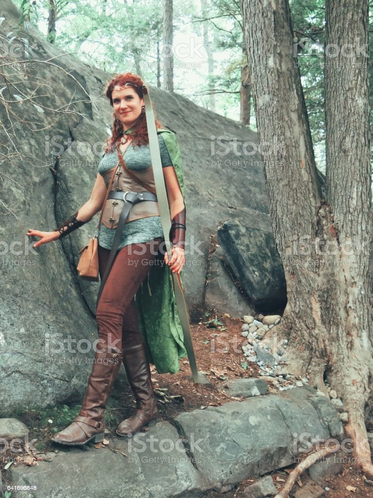 Norse Medieval Mythology Female Archer Elf Walking In Forest Glade