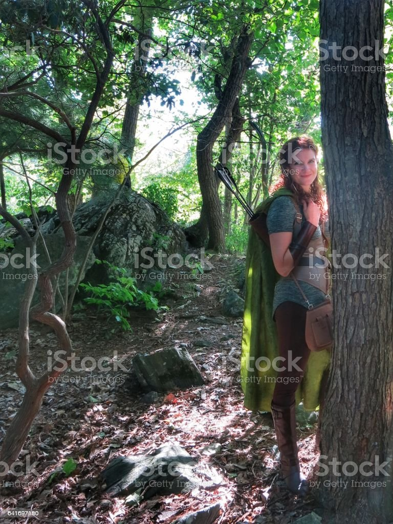 Norse Medieval Mythology, Female Archer Elf Walking in Forest Glade stock photo