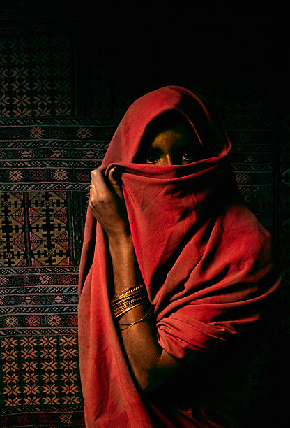 north african veiled woman - horn of africa stock photos and pictures