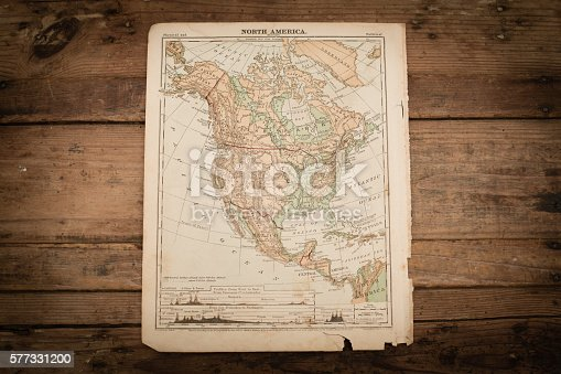 Color stock photo of an antique North America map illustration page on an old, wooden trunk. Salvaged from an 1871 geography book.