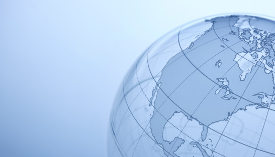 Close up of transparent globe showing North America.
