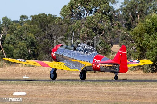 Tyabb, Australia - March 9, 2014: North American AT-6C Harvard VH-NZH single engine military training aircraft in US Navy markings from World War II taxiing at Tyabb Airport.