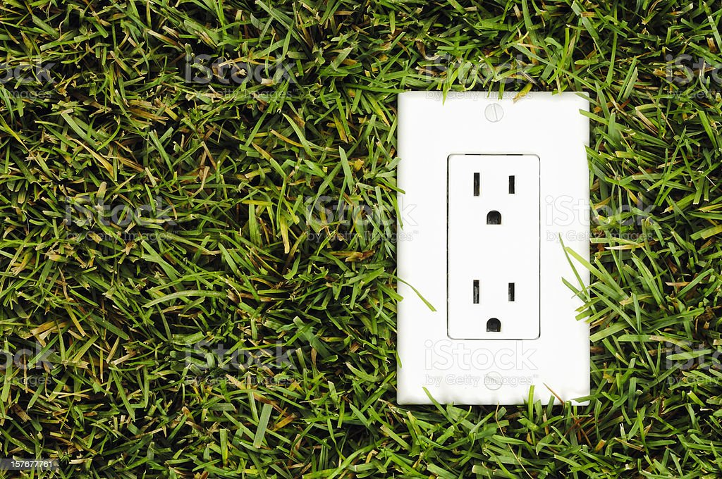 North American electrical outlet in real grass​​​ foto
