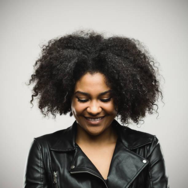 north american female model in leather jacket - guardare verso il basso foto e immagini stock