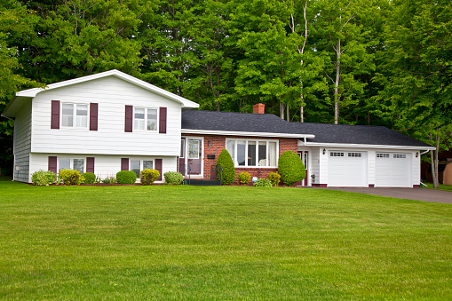 North America seventies era wooden split level home in suburbia.