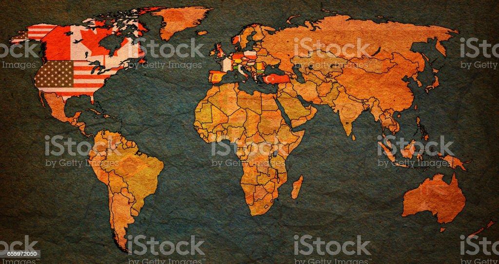 North Atlantic Treaty Organization on old vintage world map stock photo