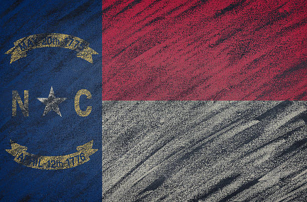 North Carolina flag painted with colored chalk on a blackboard. Close-up of national North Carolina state flag painted with colored chalk on a blackboard. 3D rendering north carolina us state stock pictures, royalty-free photos & images