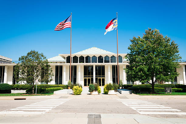 "North Carolina Legislative Building Raleigh USA ""North Carolina Legislative Building with American and North Carolina Flags in the wind. The North Carolina State Legislative Building is the meeting place of the North Carolina General Assembly, the state legislature of the U.S. state of North Carolina. Raleigh, North Carolina, USA"" federal building stock pictures, royalty-free photos & images"