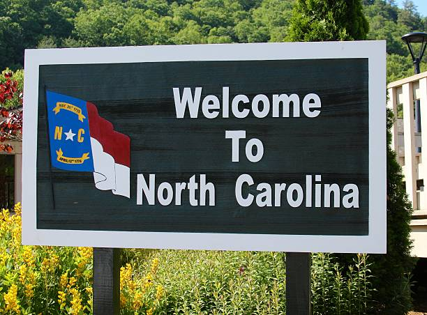 North Carolina A welcome to north carolina sign. north carolina us state stock pictures, royalty-free photos & images