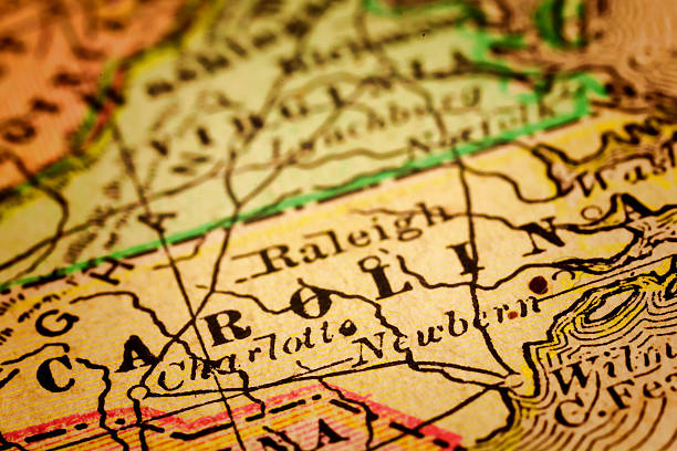 North Carolina State, United States North Carolina State, on an old 1880's map. Selective focus and Canon EOS 5D Mark II with MP-E 65mm macro lens. north carolina us state stock pictures, royalty-free photos & images