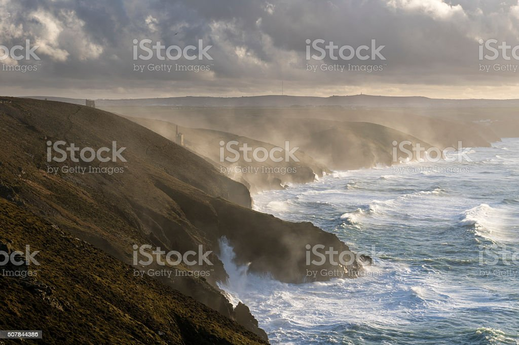 North Cornish coast in a storm with tin mine stock photo
