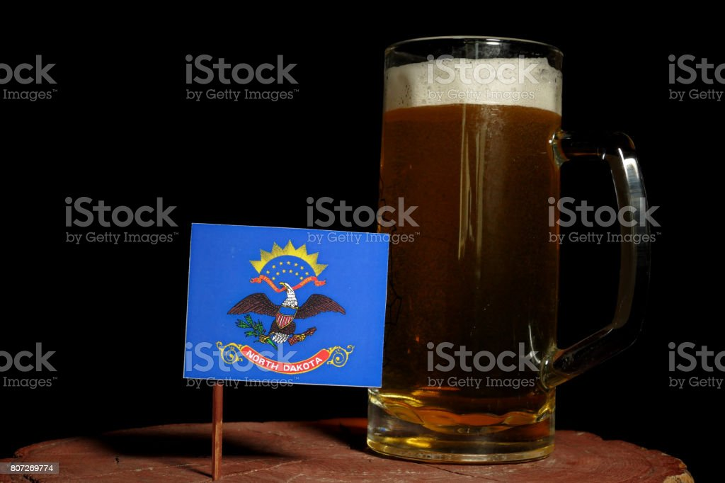 North Dakota flag with beer mug isolated on black background stock photo