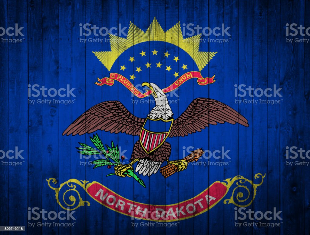 North Dakota State flag painted  on a wooden surface stock photo
