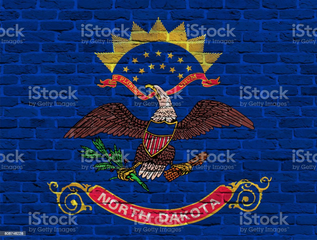 North Dakota State flag painted on stones in nature stock photo