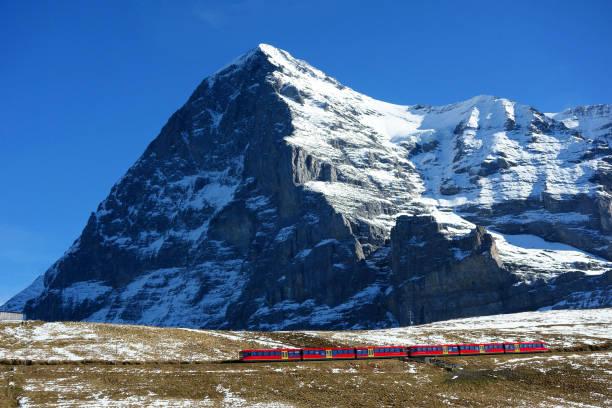 North face of Eiger mountain and Wengernalp Railway, Jungfrau region, Switzerland stock photo
