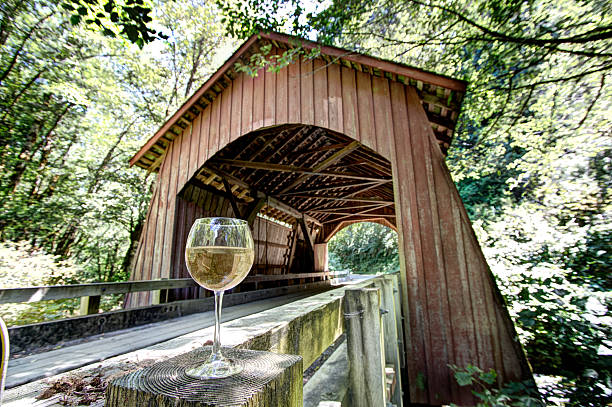 North Fork Yachats Covered Bridge Oregon Chardonnay Wine Glass HDR stock photo