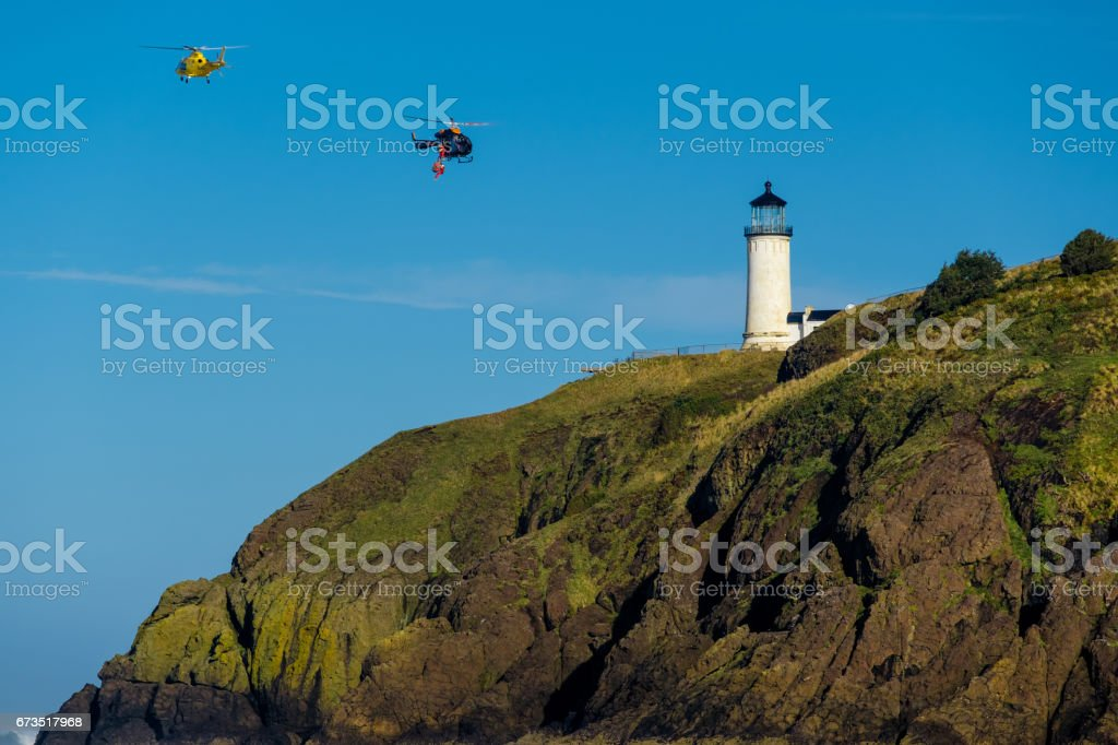 North Head Lighthouse. Coast guard helicopters in the sky. stock photo