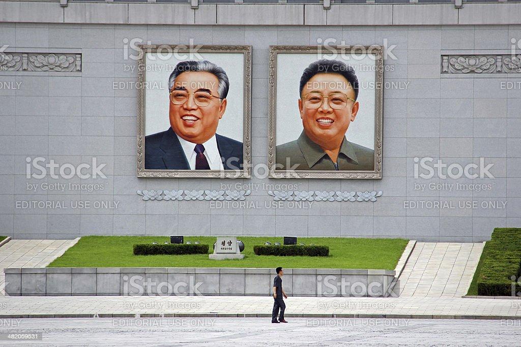North Korea DPRK: Walking across Kim Il Sung Square stock photo
