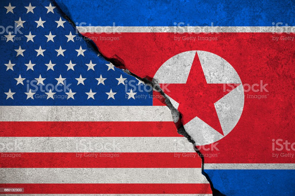 north korea flag on broken brick wall and half usa united states of america flag, crisis trump president and north korean for nuclear atomic bomb risk war stock photo