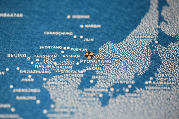 north korea missiles map north korea missiles nuclear mark for nuclear crisis,  on the blue painted map korean international circuit stock pictures, royalty-free photos & images