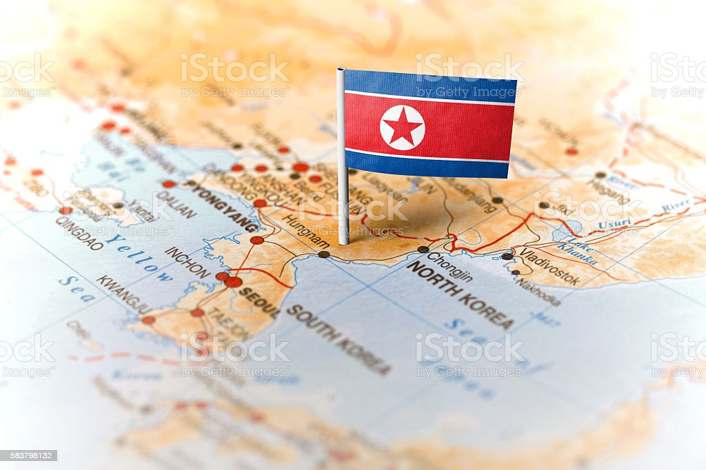 North Korea pinned on the map with flag stock photo