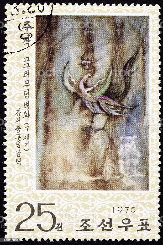 North Korean Postage Stamp Red Phoenix Cave Painting Goguryeo Koguryŏ royalty-free stock photo