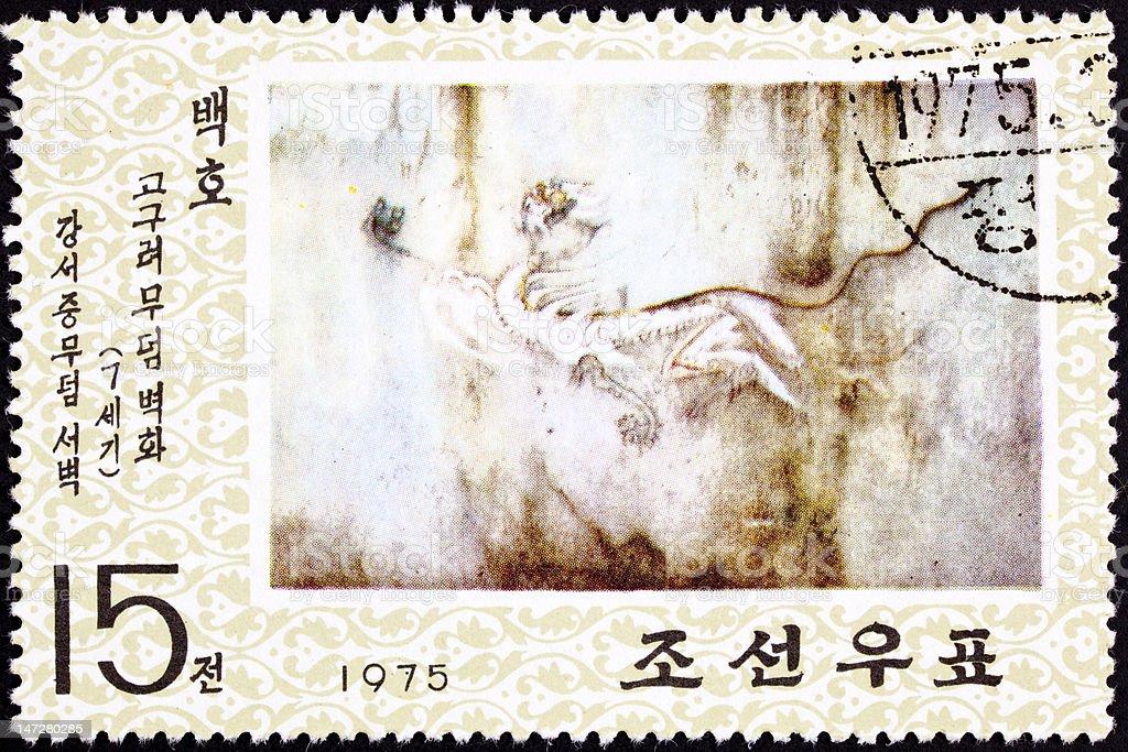 North Korean Postage Stamp White Tiger Cave Painting Goguryeo Koguryŏ royalty-free stock photo