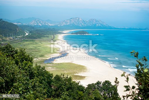 587773316 istock photo North Korea's Guard posts and railways, moutnin,sea View from the Demilitarized Zone of Goseong reunification center south korea 957624722