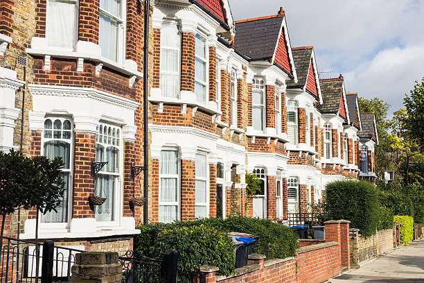 North London Terraced Housing A row of terraced houses in the Queen's Park area of London. north stock pictures, royalty-free photos & images