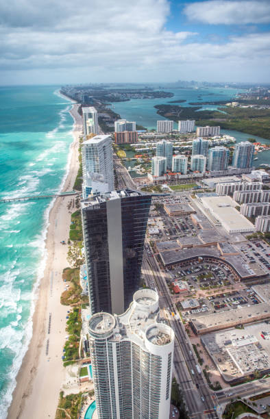 north miami beach as seen from helicopter. skyscrapers along the ocean, aerial view - south stock photos and pictures