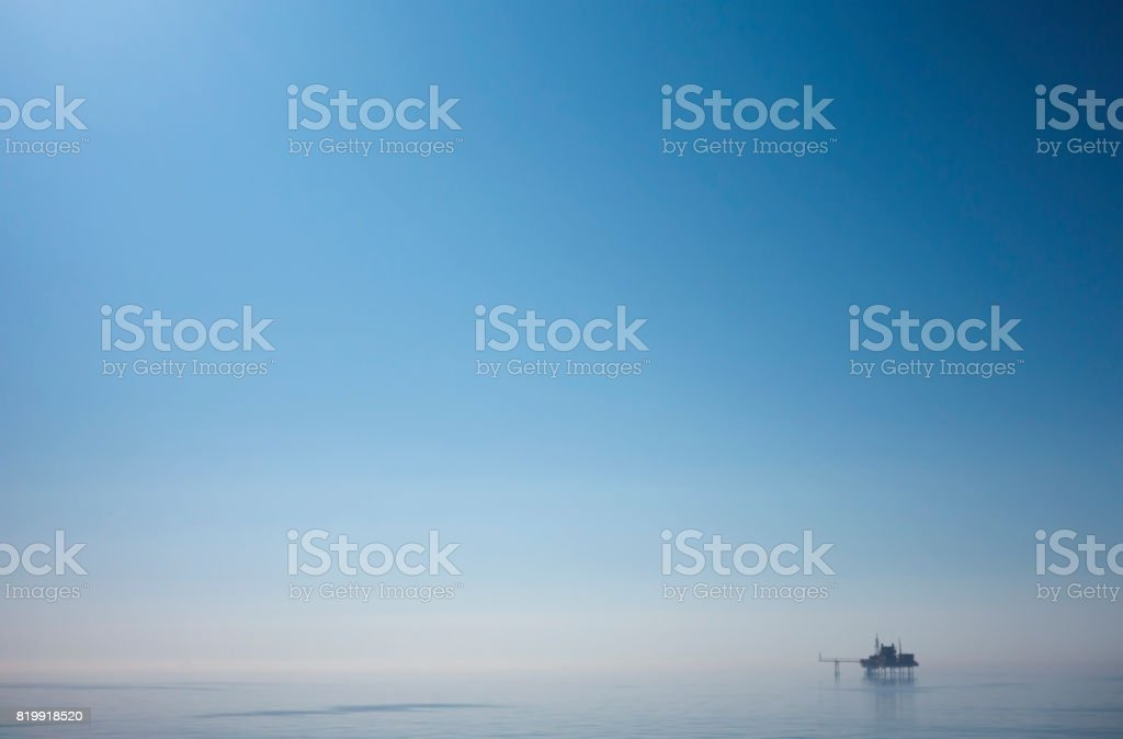 North Sea drilling platform and early morning sky stock photo