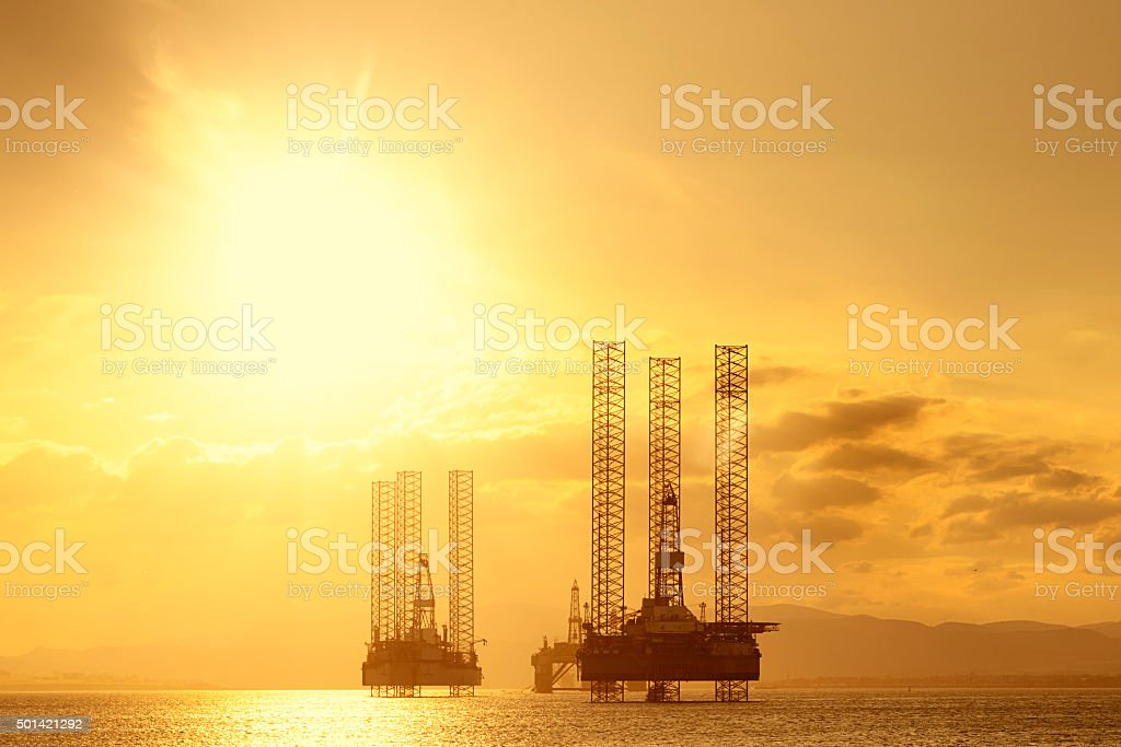 North Sea Oil Platforms at Sunset, Cromarty Firth, Scotland royalty-free stock photo